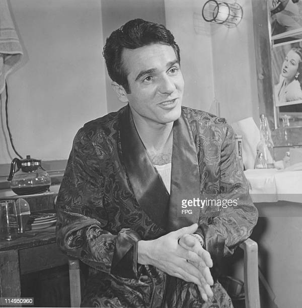 American jazz drummer and bandleader Gene Krupa in his dressing room at the Paramount Theater circa 1940
