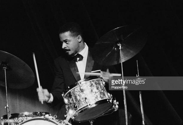 American jazz drummer Jimmy Cobb performs live on stage with the Miles Davis Quintet at the Gaumont Palace venue in Hammersmith London in October 1960