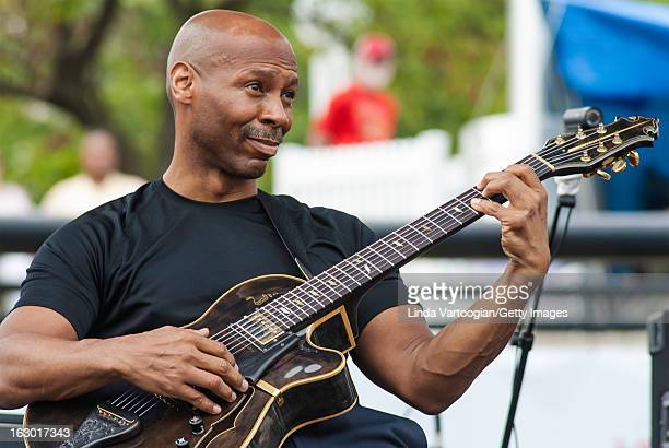 American jazz guitarist Kevin Eubanks leads his trio on the Carhartt Amphitheatre Stage at the 33rd Annual Detroit Jazz Festival Detroit Michigan...