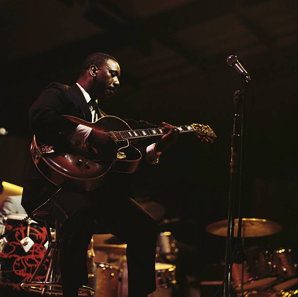Jazz guitarist Wes Montgomery performs on stage at...