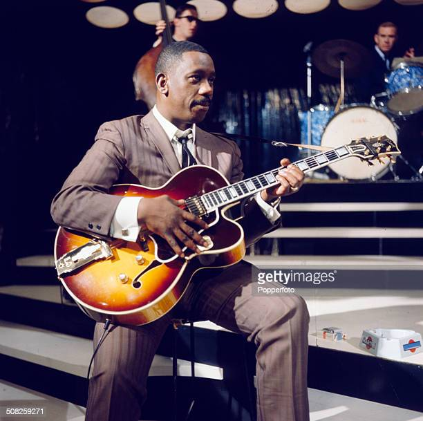 American jazz guitarist Wes Montgomery performs with a Gibson L5 semi acoustic guitar in a television studio during a recording for the television...