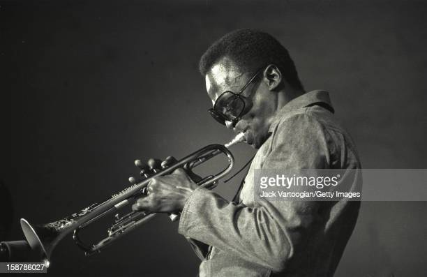American jazz msuician Miles Davis plays trumpet during the Schaefer Music Festival at Central Park's Wollman Rink New York New York July 8 1969