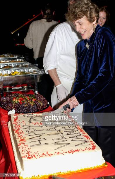 American Jazz music advocate and nightclub owner Lorraine Gordon smiles as she cuts a cake at the 70th anniversary party of her club the Village...