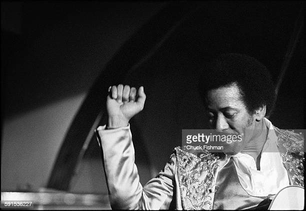 American Jazz musician Allen Toussaint plays guitar as he performs onstage during the New Orleans Jazz Festival New Orleans Louisiana April 1977