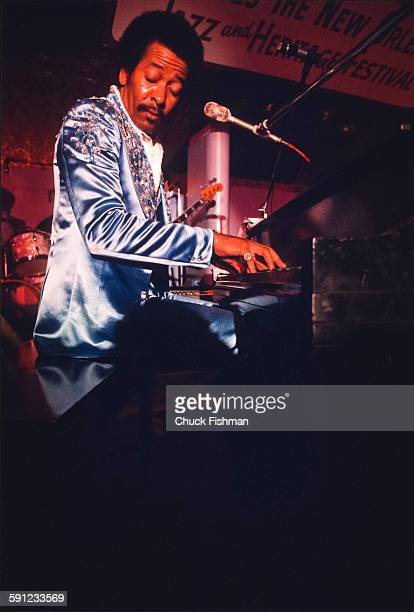 American Jazz musician Allen Toussaint plays piano as he performs onstage during the New Orleans Jazz Festival New Orleans Louisiana 1977
