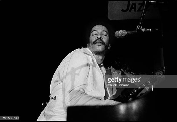 American Jazz musician Allen Toussaint plays piano as he performs onstage during the New Orleans Jazz Festival New Orleans Louisiana April 1977