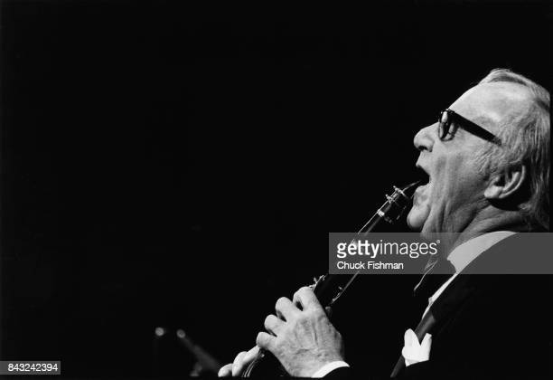 American Jazz musician and bandleader Benny Goodman plays clarinet as he performs onstage during his 40th anniversary concert at Carnegie Hall, New...