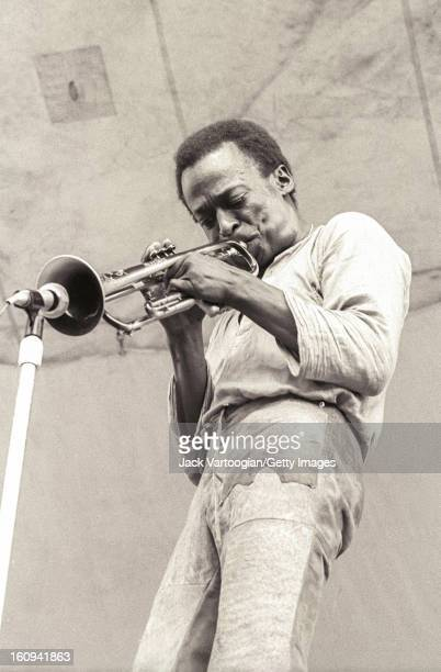 American jazz musician and composer Miles Davis on trumpet performs at the Schaefer Music Festival series at Wollman Rink Central Park New York New...