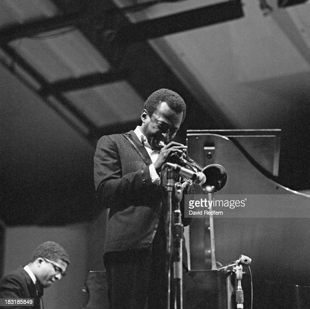American jazz musician and composer Miles Davis performing at the Newport Jazz Festival Newport Rhode Island 2nd July 1967 On the left is pianist...