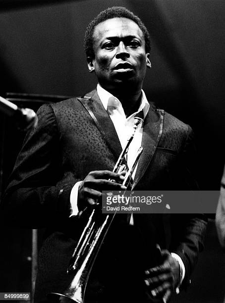 FESTIVAL Photo of Miles DAVIS Performing live onstage looking to camera