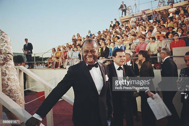 American jazz musician and trumpeter Louis Armstrong pictured attending the 40th Academy Awards at the Santa Monica Civic Auditorium in Santa Monica...