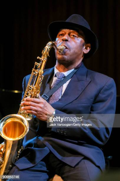 American Jazz musician Archie Shepp plays tenor saxophone as he performs onstage during the 'Archie Shepp/Roswell Rudd Live in New York' concert at...