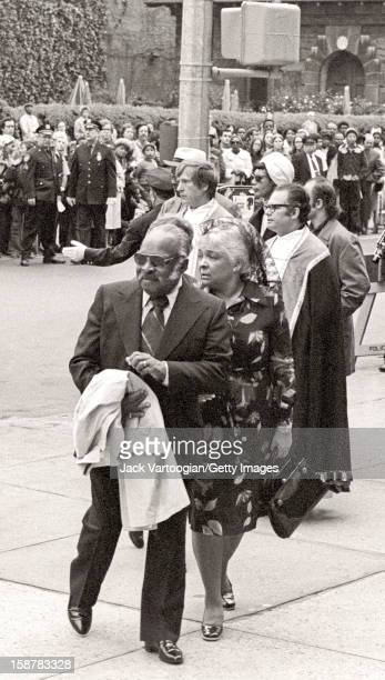 American jazz musician band leader and composer Count Basie and his wife Catherine arrive for Duke Eliington's funeral at the Cathedral of Saint John...