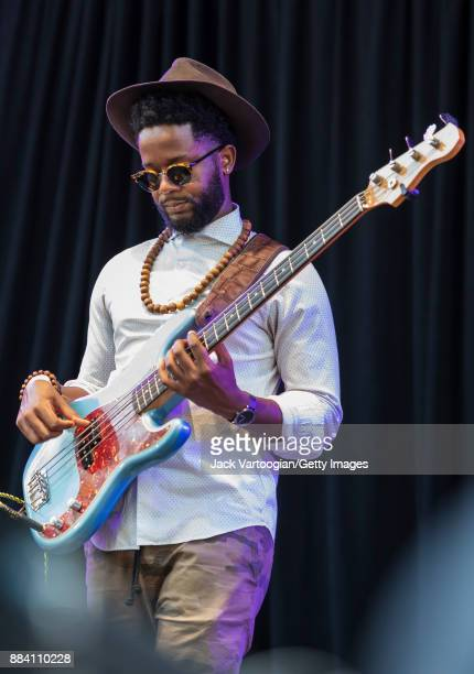 American Jazz musician Ben Williams plays electric bass guitar as he performs with Alicia Olatuja's band on the final day of the 25th Annual Charlie...