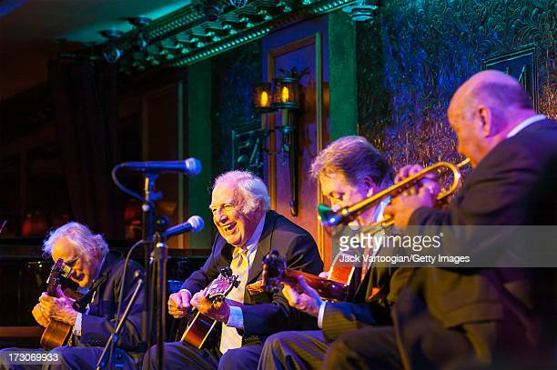 American jazz musician Bucky Pizzarelli plays guitar with his band 'Bucky Pizzarelli and the Great Guitars' during aperformance at the 54 Below...