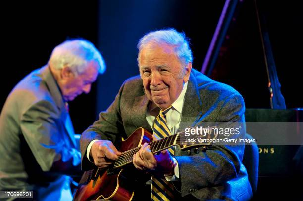 American jazz musician Bucky Pizzarelli plays guitar with the Ken Peplowski Quintet during the Jazz at Lincoln Center's 'American Anthems' concert at...