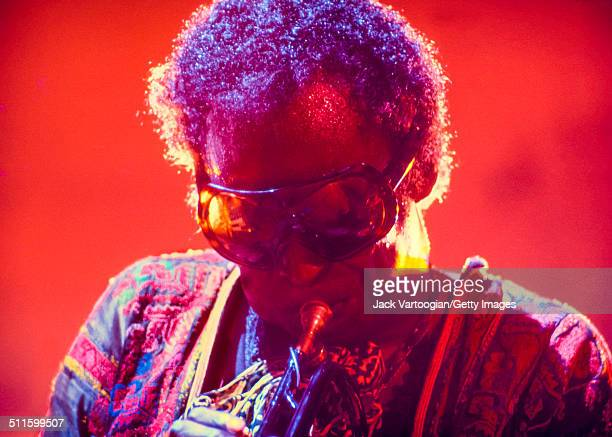 American Jazz musician composer and bandleader Miles Davis plays trumpet during a performance in the Schaefer Music Festival series at Central Park's...