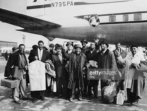 American jazz musician Count Basie and his orchestra arrive at London Airport for a tour of Britain 4th April 1957 Basie is in the front centre with...