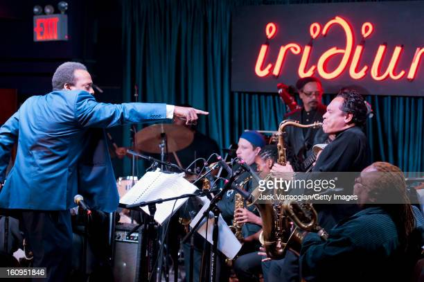American jazz musician David Murray leads his Blues Big Band as he points at saxophonist Jay Rodriguez during a performance at Iridium New York New...