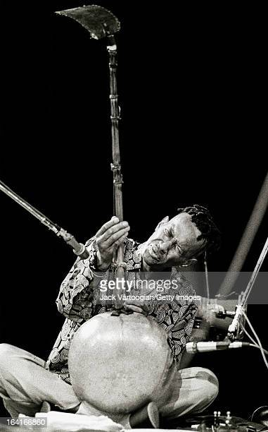 American jazz musician Don Cherry plays a West African dousongoni at the World Music Institute's 'World of Percussion' concert at Symphony Space New...