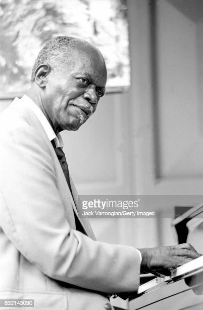 American Jazz musician Hank Jones plays piano as he performs at the 3rd Annual Charlier Parker Jazz Festival in Tompkins Square Park New York New...