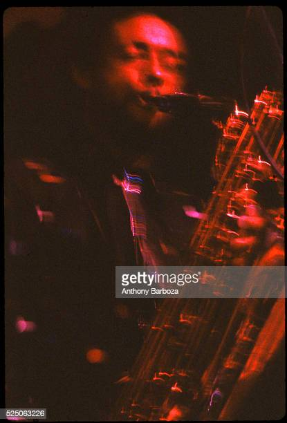 American Jazz musician Henry Threadgill plays saxophone as he performs onstage New York New York 1980s
