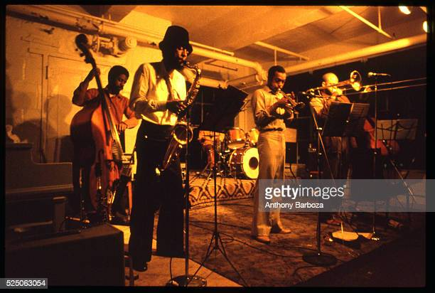 American Jazz musician Henry Threadgill plays saxophone as he performs onstage with his sextet in a loft at 450 West 31st Street New York New York...