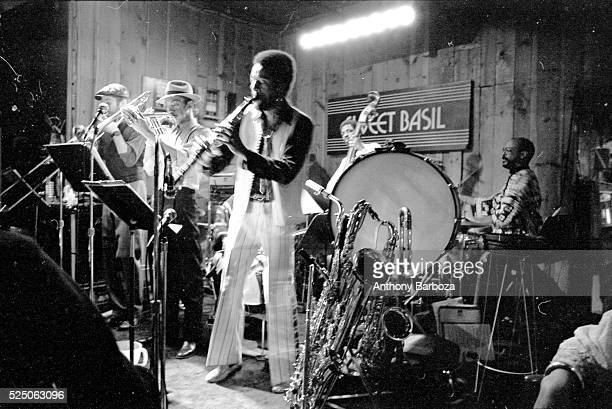 American Jazz musician Henry Threadgill plays saxophone as he performs onstage with his sextet at the Sweet Basil nightclub New York New York 1983