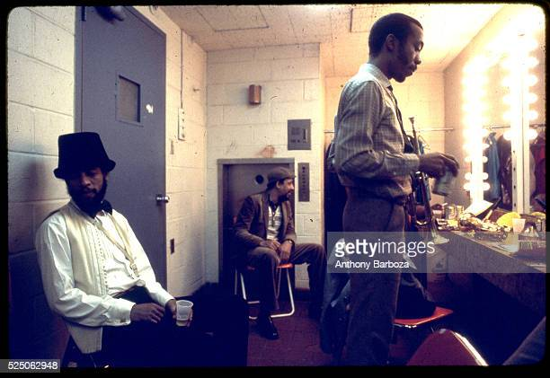 American Jazz musician Henry Threadgill trumpet player Olu Dara and unidentified others relax backstage at the Sweet Basil nightclub New York New...