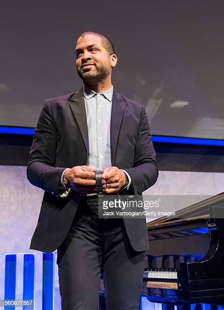 American Jazz musician Jason Moran holds a wristwatch as he stands beside a piano in the David Rubenstein Atrium at Lincoln Center New York New York...