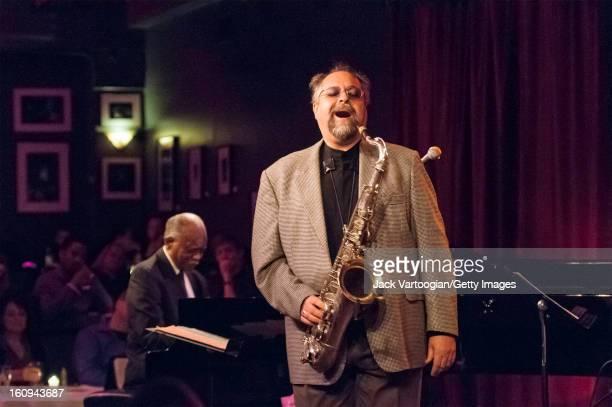 American jazz musician Joe Lovano on tenor saxophone leads his quartet at Birdland New York New York April 8 2009 Pianist Hank Jones is at left