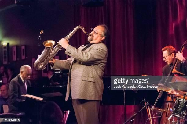 American jazz musician Joe Lovano on tenor saxophone leads his quartet at Birdland New York New York April 8 2009 Pictured are from left Hank Jones...