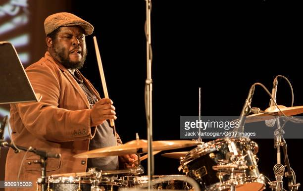 American Jazz musician Johnathan Blake plays drums as he performs with the Arturo O'Farrill Band during a 'Musicians Against Fascism' benefit concert...