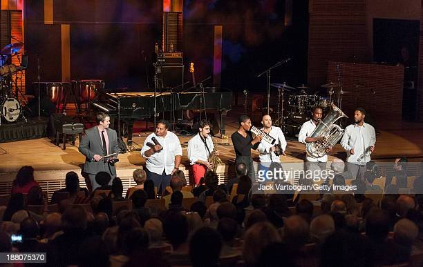 American Jazz musician Jonathan Batiste plays melodica as he leads his band Stay Human during a Joyce and George Wein Foundation series 'The Shape of...