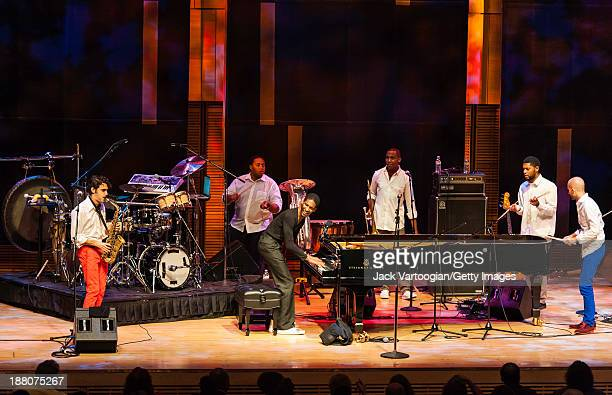 American Jazz musician Jonathan Batiste plays piano as he leads his band Stay Human during a Joyce and George Wein Foundation series 'The Shape of...