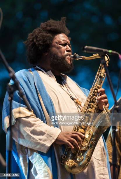 American Jazz musician Kamasi Washington plays tenor saxophone with his band during the Blue Note Jazz Festival at Central Park SummerStage New York...