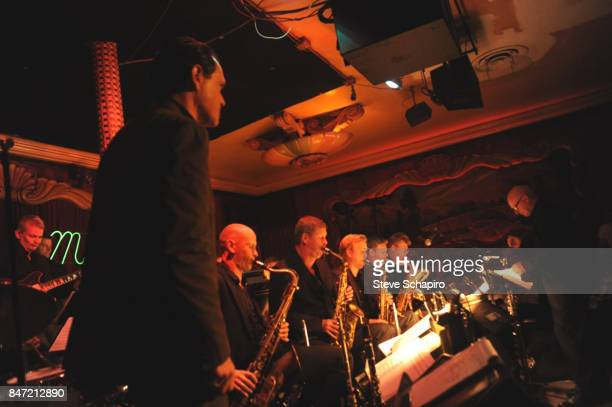 American Jazz musician Kurt Elling watches as Jens Kluver conducts the Kluvers Big Band during a performance onstage at the Green Mill Cocktail...