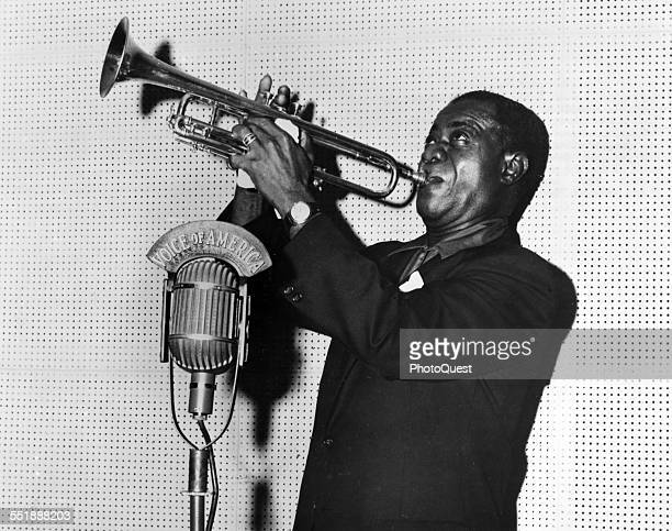 American Jazz musician Louis Armstrong plays trumpet during a Voice of American radio broadcast, Washington DC, 1960.