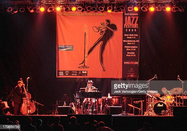 American jazz musician Ornette Coleman plays alto saxophonist during a reunion performance of his trio, including upright acoustic bassist Charlie...