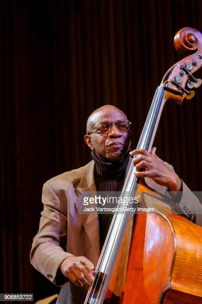 American Jazz musician Reggie Workman plays upright acoustic bass as he performs onstage during the 'Archie Shepp/Roswell Rudd Live in New York'...