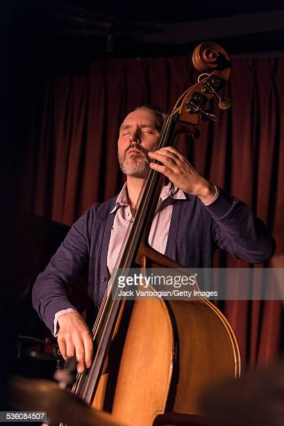 American Jazz musician Reid Anderson of the Bad Plus plays on upright acoustic bass during a performance at the Village Vanguard New York New York...
