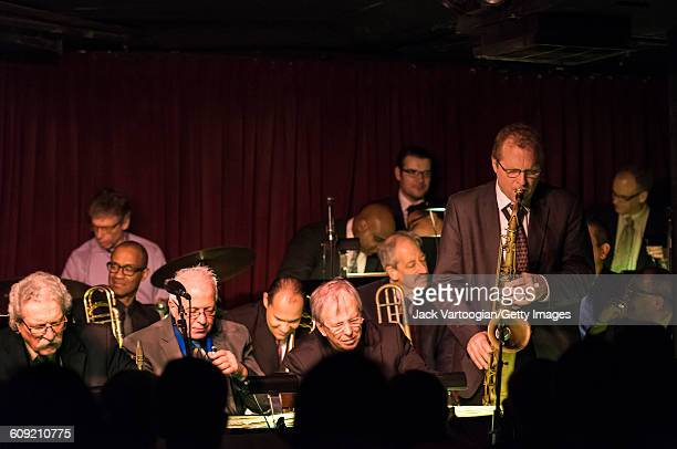 American Jazz musician Rich Perry plays tenor saxophone as he solos with the Vanguard Jazz Orchestra at the Village Vanguard New York New York...