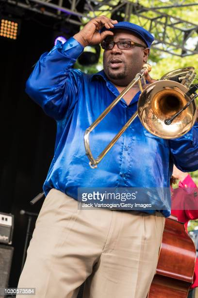 American Jazz musician Ronell Johnson plays trombone with the Preservation Hall Jazz Band at 'Voodoo Threauxdown' at Central Park SummerStage New...