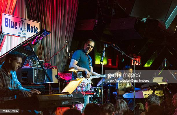 American Jazz musician Stanley Clarke plays elctric bass as he leads his band at the Blue Note nightclub, New York, New York, November 4, 2015. With...