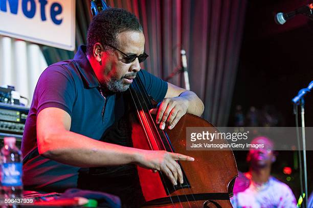 American Jazz musician Stanley Clarke plays upright acoustic bass as he leads his band at the Blue Note nightclub, New York, New York, November 4,...