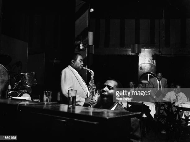 American jazz musicians Charlie Parker and Thelonious Monk perform at the Open Door Cafe New York City September 14 1953