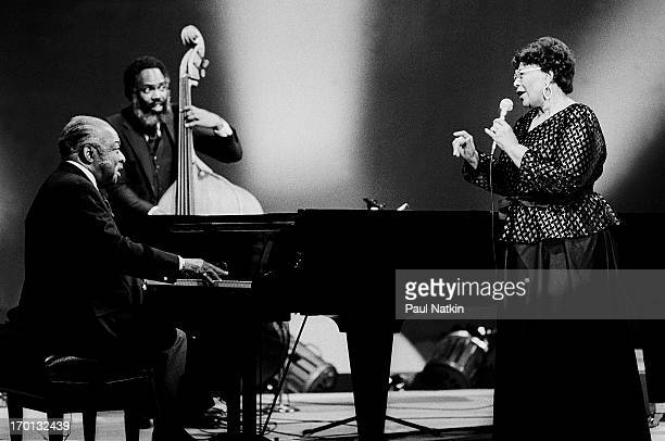 American jazz musicians Count Basie on piano Cleveland Eaton on bass and Ella Fitzgerald on vocals perform during a recording of an episode of the...