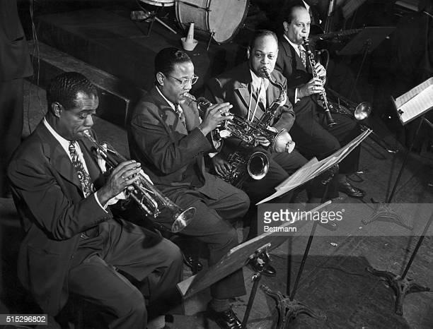 American jazz musicians Louis Armstrong, Roy Eldridge, Coleman Hawkins, Barney Bigard during a concert.
