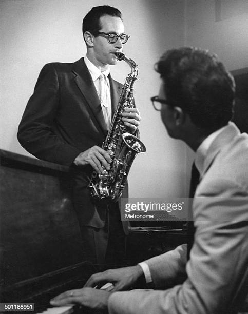 American jazz musicians Paul Desmond , on saxophonist, and Dave Brubeck , on piano, perform together in a studio, 1940s or 1950s.