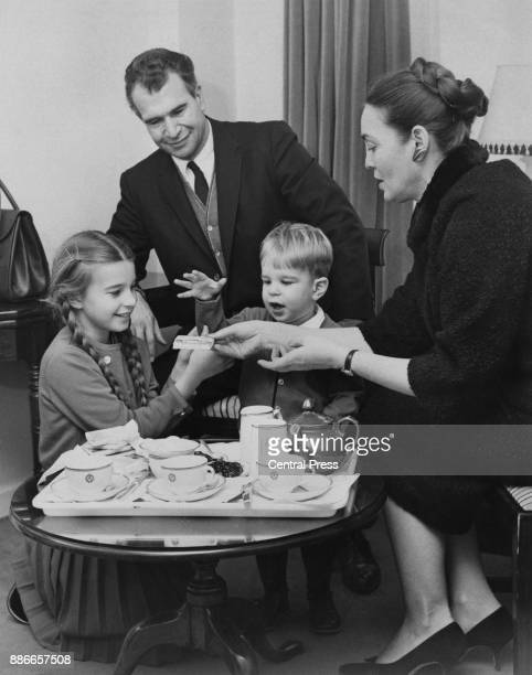 American jazz pianist and composer Dave Brubeck eats breakfast in his London hotel with his wife Iola and their children Matthew and Catherine, 16th...
